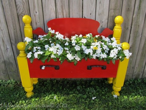 bed repurposed into flowerbed
