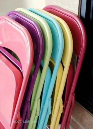 coloful spray painted folding metal chairs