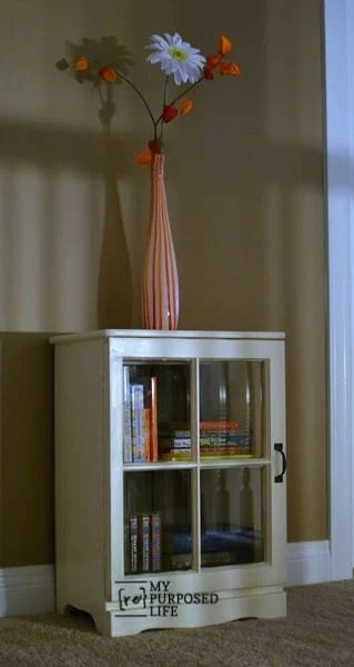 book cabinet made from an upcycled nightstand and an old window
