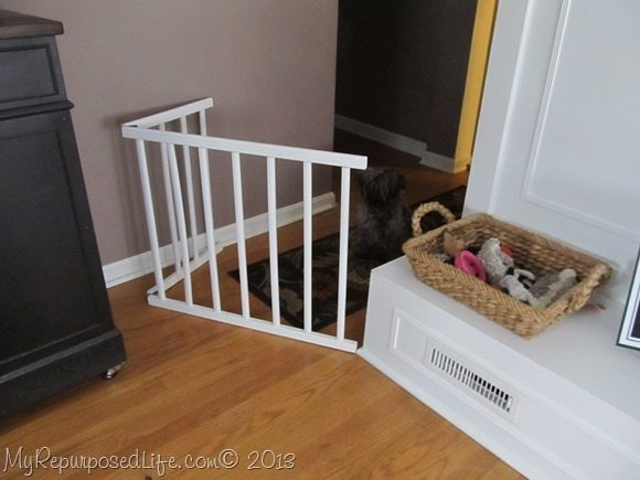 repurposed crib rails make a diy doggie gate