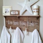 curtain tie backs repurposed into towel hooks