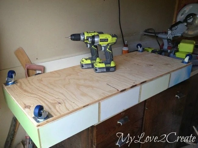 Adding casters to bottom of under the bed storage