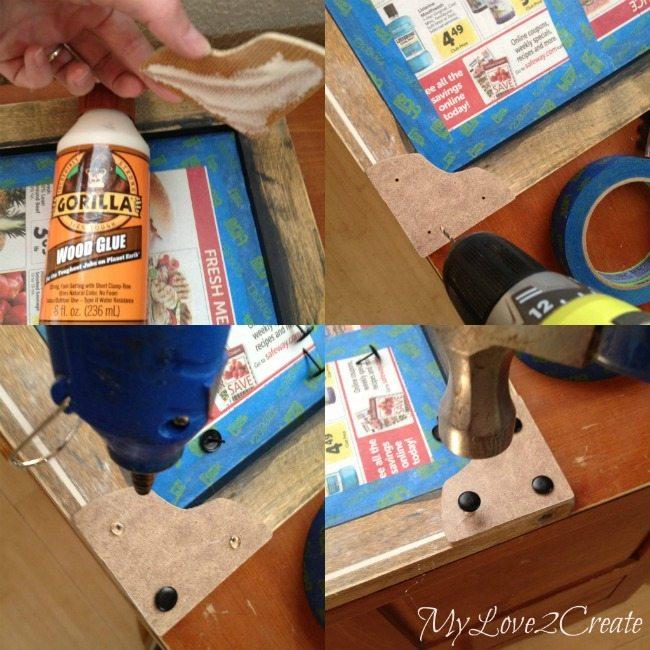 Using upholstery tacks to make fake rivets