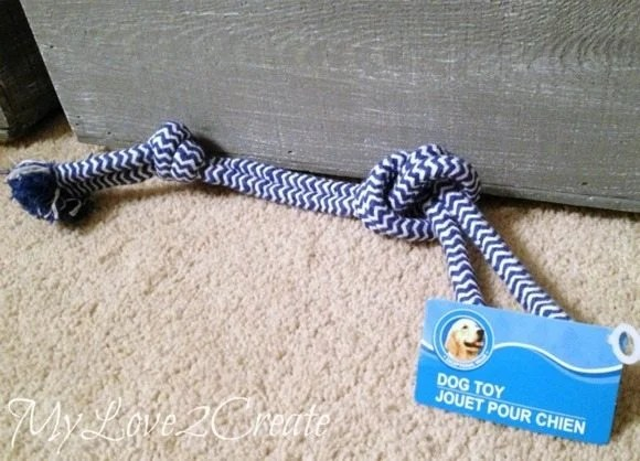 Dog toy to be used as a rope handle