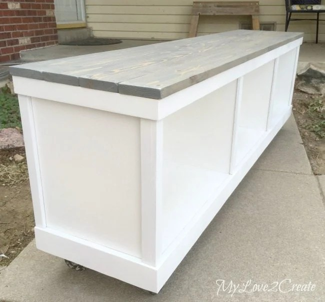 long side view of cheap cabinet to nice bench