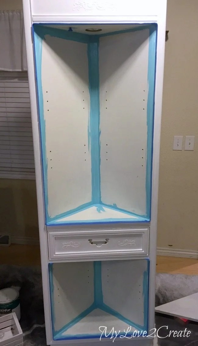 painting inside of cabinet
