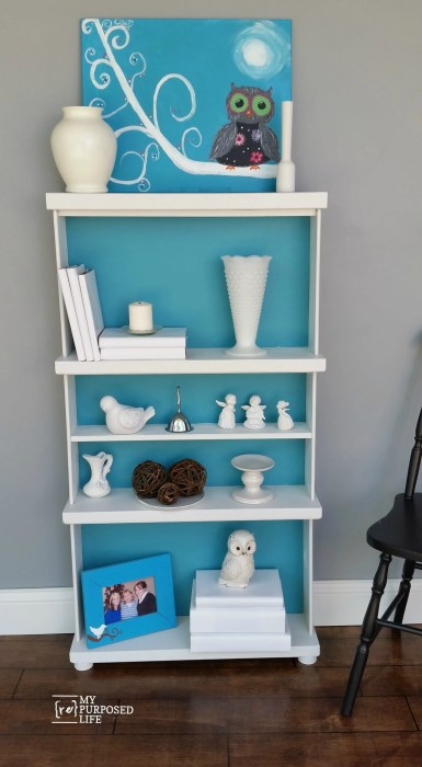 turquoise and white bookshelf made from repurposed drawers