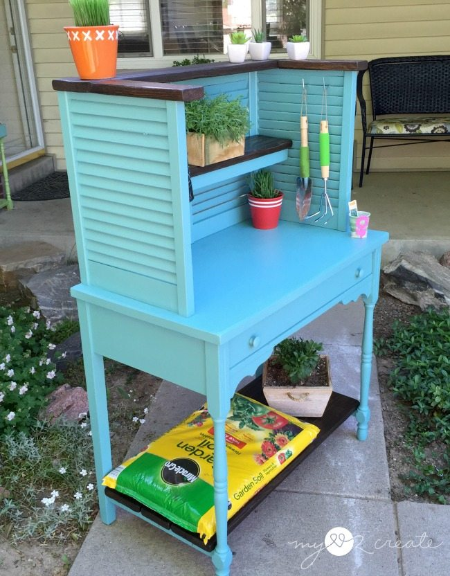 side shot of potting bench repurposed from shudders and desk