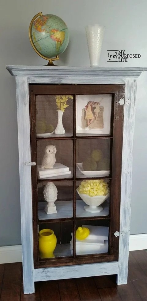 A reclaimed window and other scrap pieces of wood are combined to make a tall window cabinet for displaying items in your home decor. Step by step directions with lots of tips! #MyRepurposedLife #repurposed #window #tall #floor #cabinet #project #homedecor via @repurposedlife