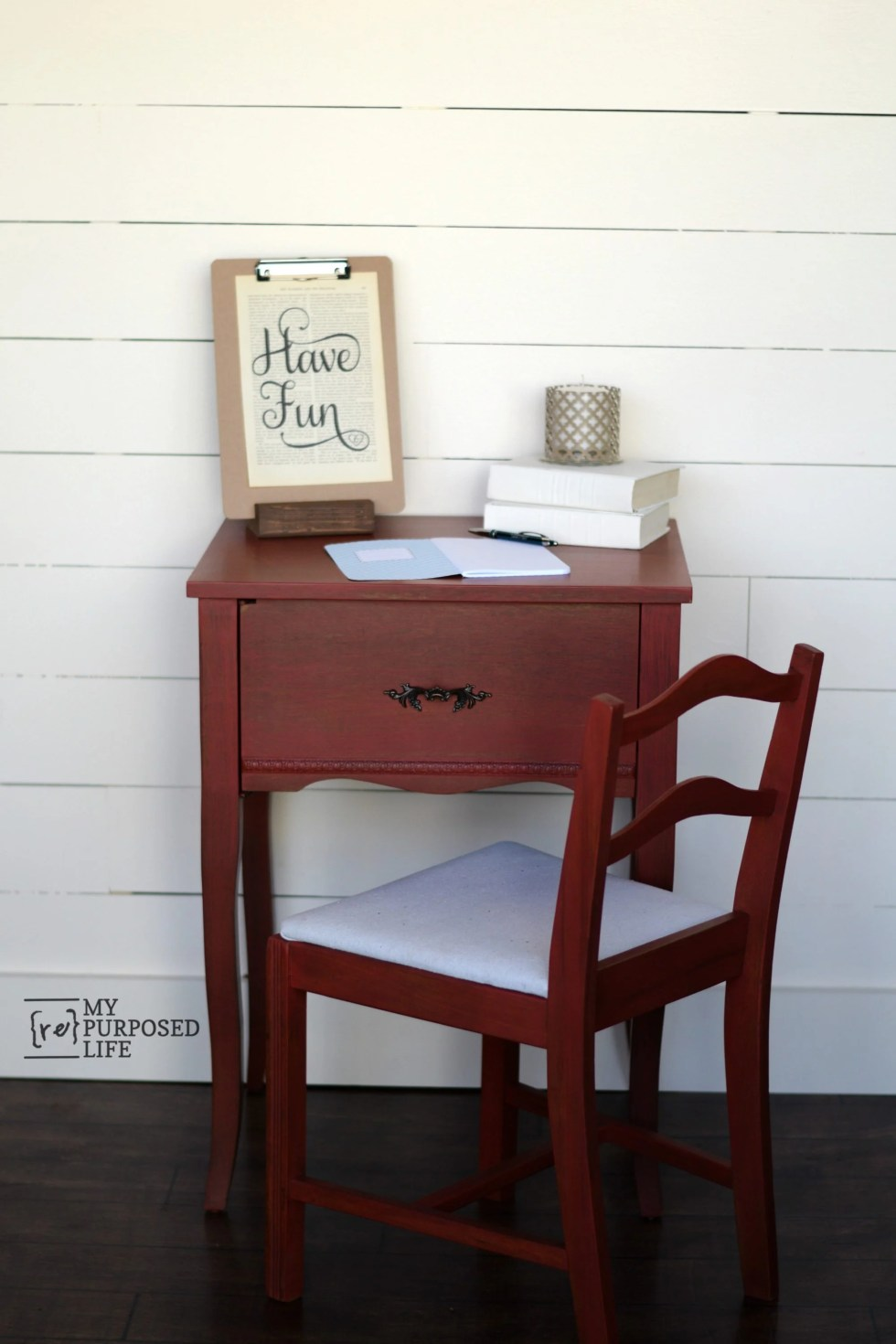 How to turn a sewing cabinet into a fun red side table. The side table paired with a chair makes a great writing desk. Easy project for even a beginner.  #MyRepurposedLife #repurposed #furniture #sewing #cabinet #easy #diy #project via @repurposedlife
