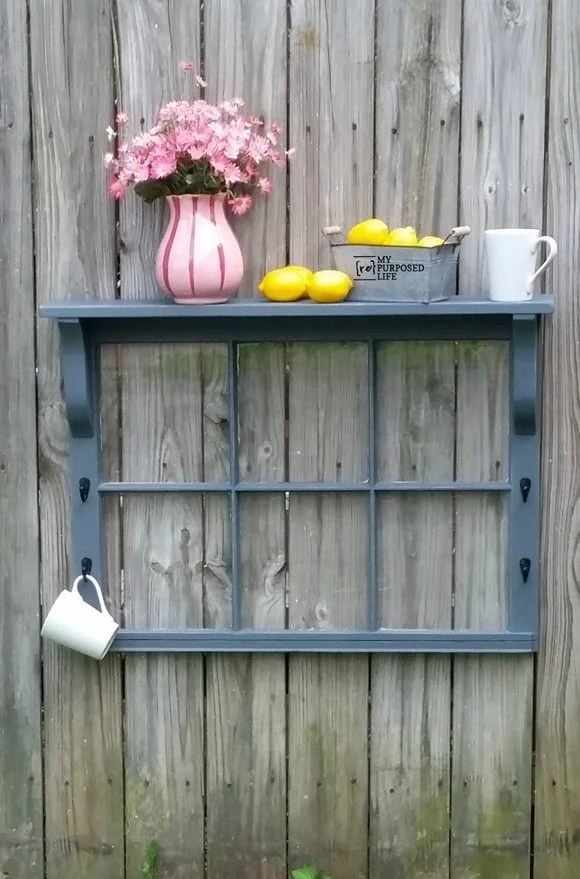 Step by step directions on how to repurpose a window by adding scrap wood pieces to turn it into a window shelf! Easy project to do in an afternoon. What color will you paint yours?