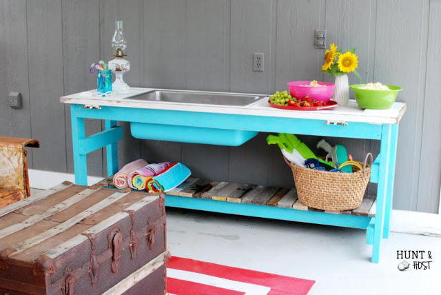 outdoor party buffet with salvaged sink and door
