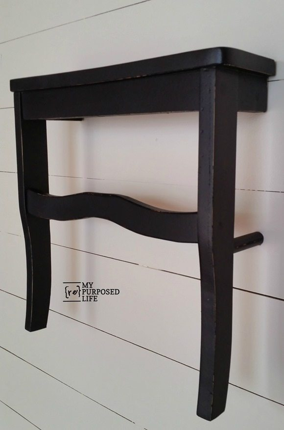 black wall shelf made from a chair seat MyRepurposedLife.com