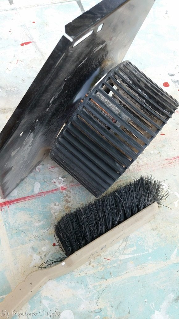clean fan with dust brush