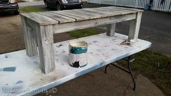 whitewashed outdoor bench or table
