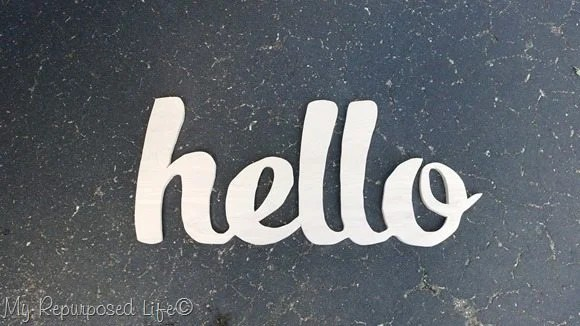 wooden hello sign