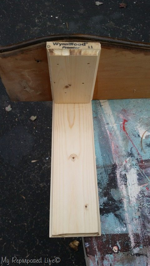 attach bracket back boards to shelf