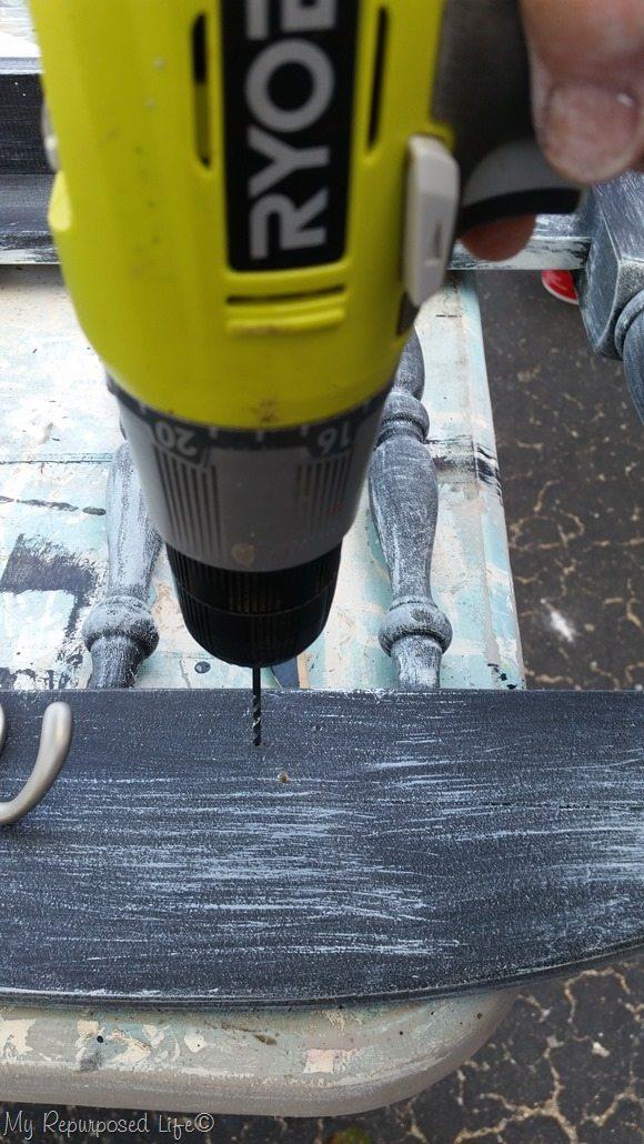 drill pilot holes for coat hooks on  distressed chalkboard coat rack