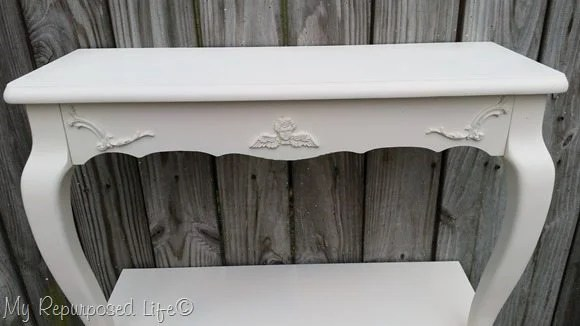 painted table shelves with appliques