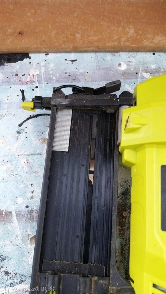 nail gun to secure false bottom