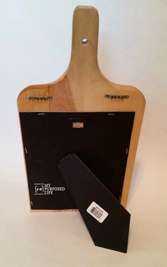 picture frame easel to make chalkboard cookbook kitchen stand out of a cutting board MyRepurposedLife.com