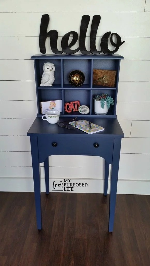 How to marry a sewing machine cabinet and a repurposed drawer to make this small navy blue writing desk. Step by step directions to make something similar for your own home.  #MyRepurposedLife #repurposed #furniture #sewingcabinet #writingdesk #desk #diy #project via @repurposedlife