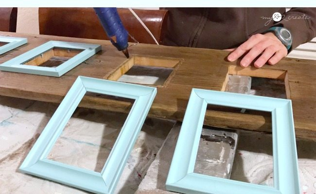 hot glue frames over openings in wood