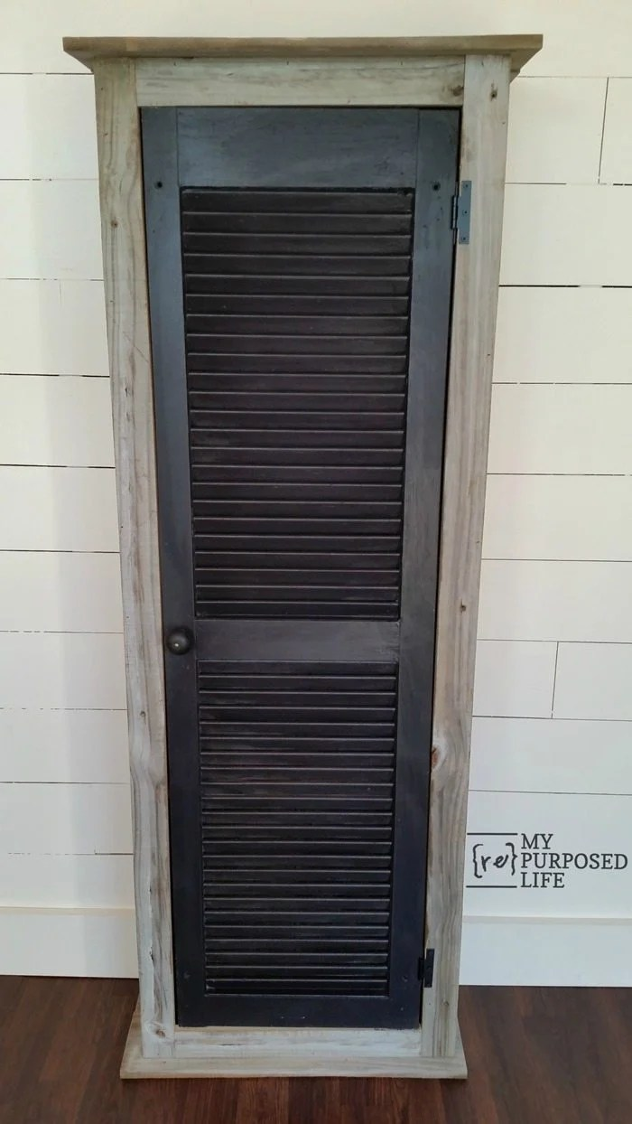 How to make a rustic shutter cabinet using an old shutter and reclaimed wood. Step by step directions so you can Do It Yourself. This cabinet is perfect for a small bathroom, guestroom, or mudroom. Put in in the kitchen for extra pantry storage. #MyRepurposedLife #Repurposed #upcycled #shutter via @repurposedlife