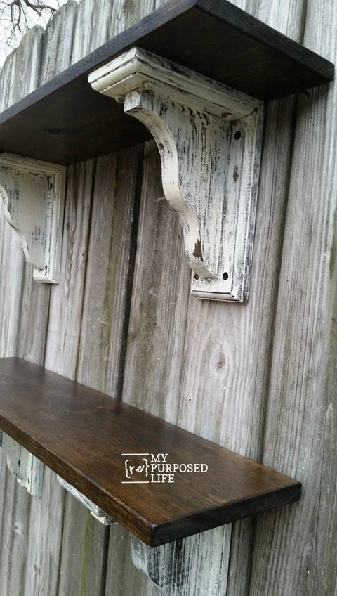 Easy to Make Farmhouse shelves for your home. Tutorial on assembling shelves using pre-made corbels. Tips on painting and staining the perfect farmhouse look. #MyRepurposedLife #repurposed #farmhouse #shelf #diy #project via @repurposedlife