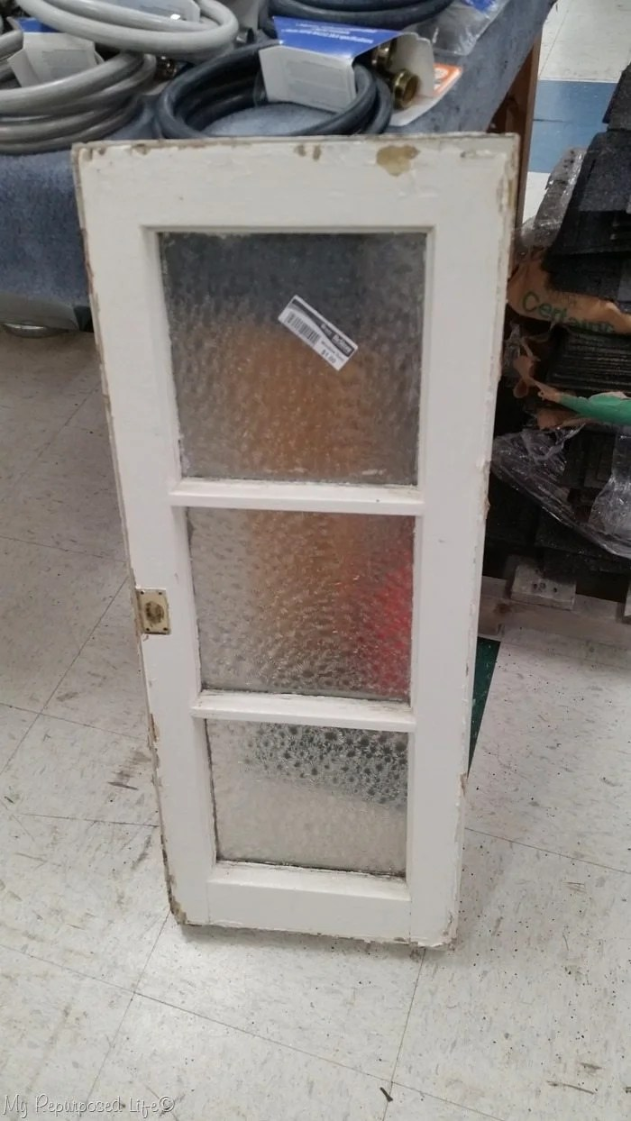 one dollar frosted vintage window
