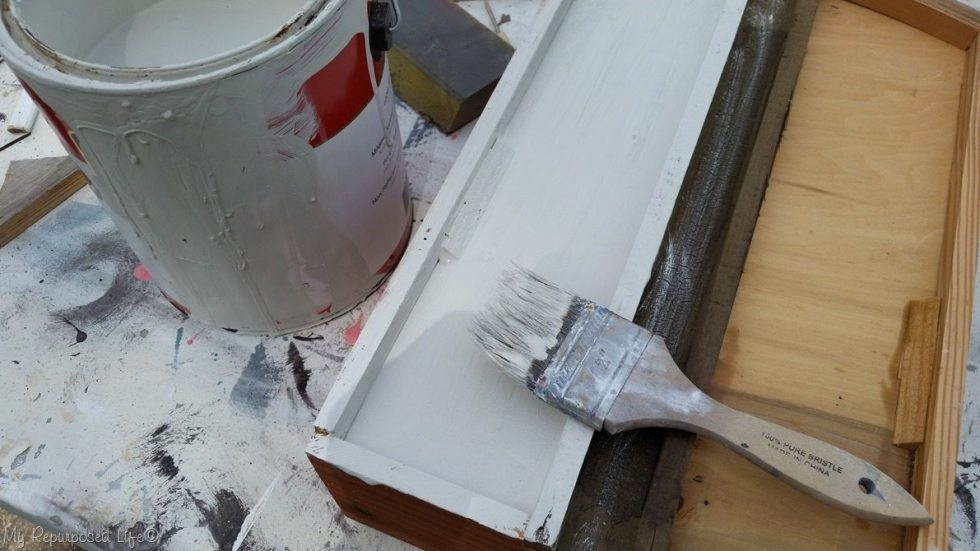 apply primer to vintage drawer shelf