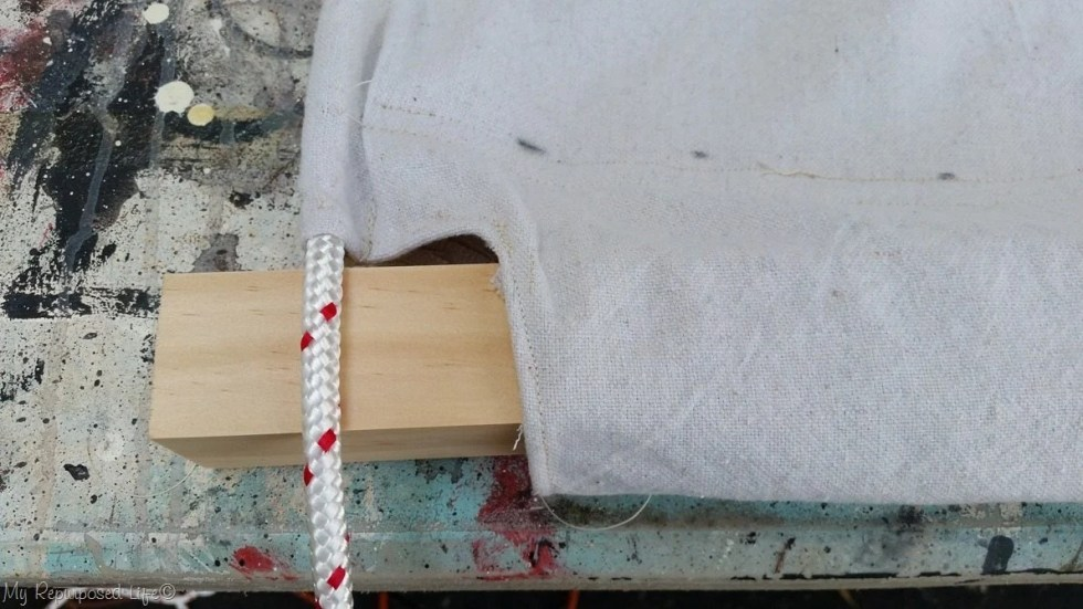 insert 2x2 into hem of diy drop cloth hammock