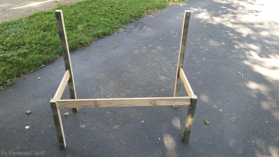 design stage wooden slat bench with back