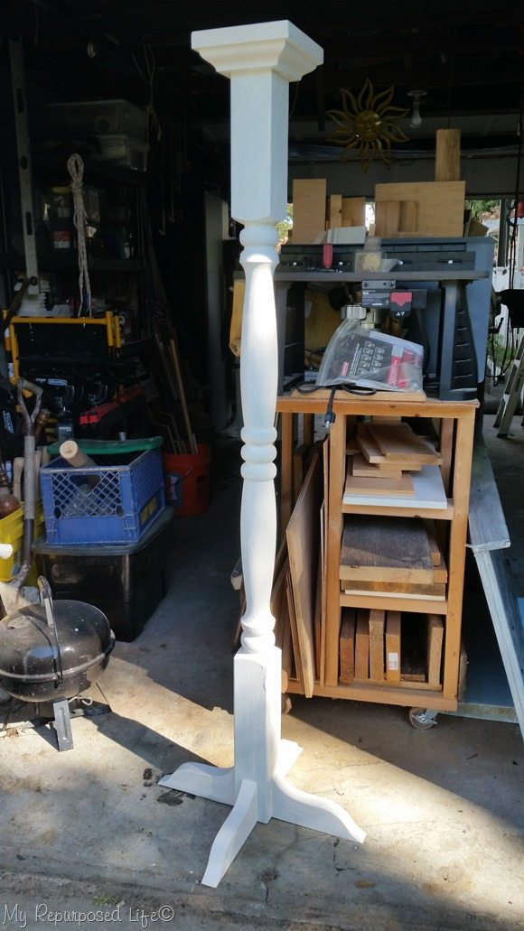 white porch post coat rack