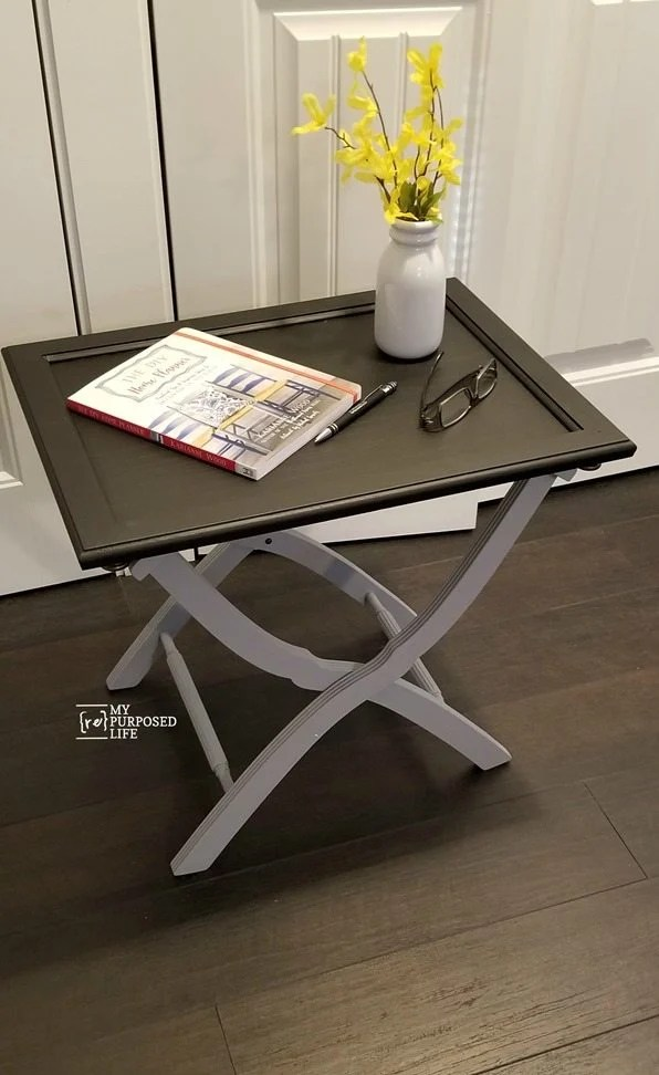 use a luggage rack and a cabinet door to make a useful side table breakfast tray lap desk MyrRepurposedLife.com