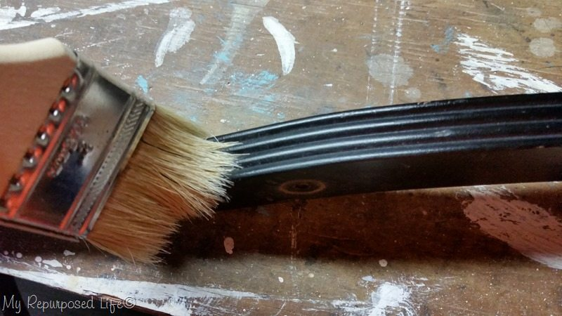 use paintbrush to dust grooves
