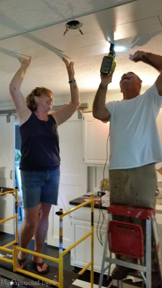use scafold to install planks to cover up popcorn ceiling