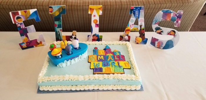 decoupage wooden letters with its a small world cake baby shower
