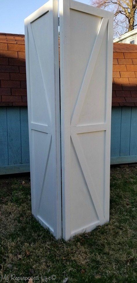 faux barn doors basement laundry room