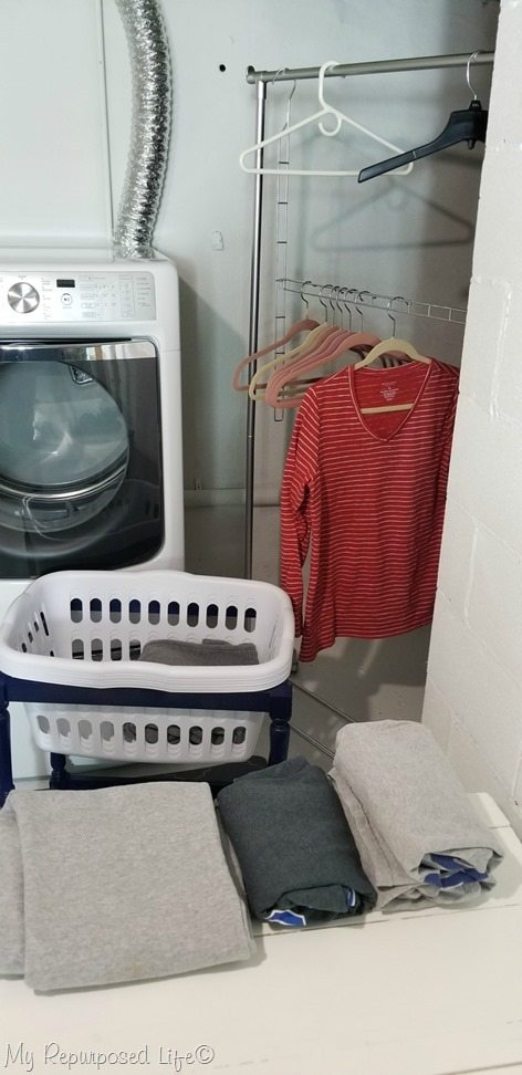 refreshed basement laundry space with painted garment rack