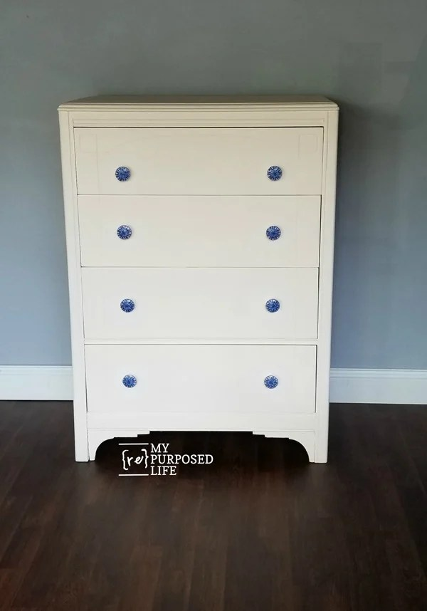 antique white dresser with decoupaged blue knobs MyRepurposedLife.com
