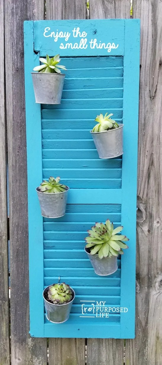 repurposed shutter holding galvanized pots with succulents MyRepurposedLife.com