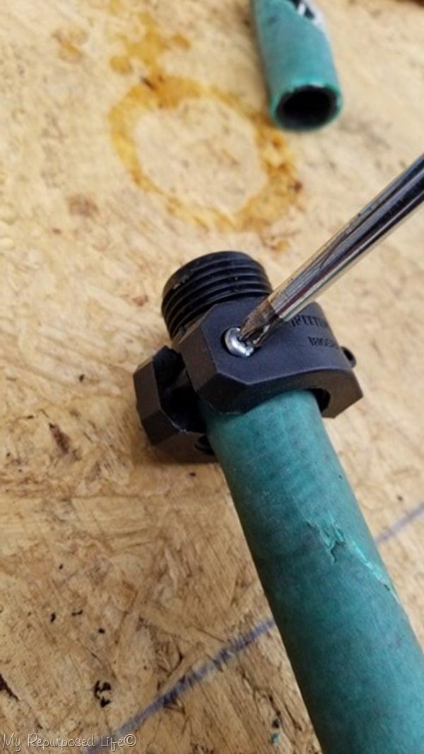 tighten screws on sleeve to make hose repair