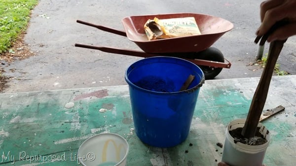 insert hammer into mortar mix