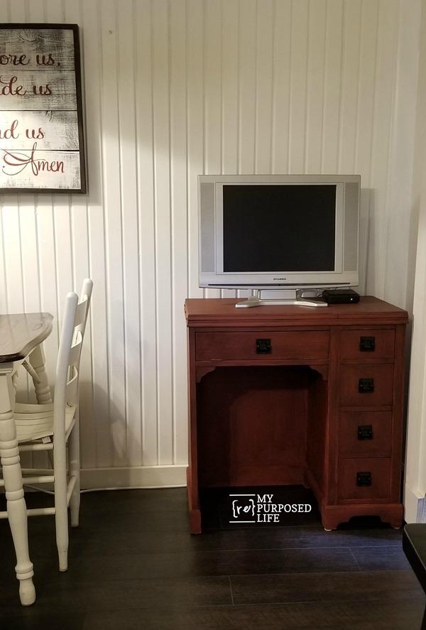 red glazed vintage sewing desk cabinet in the kitchen MyRepurposedLife.com