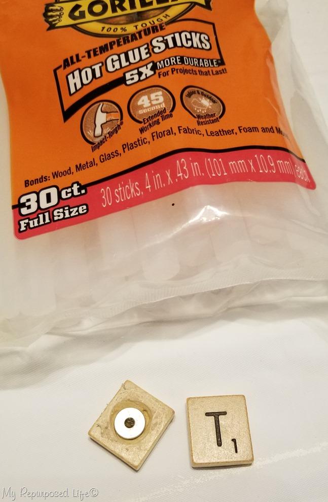 hot glue super magnet to scrabble tile