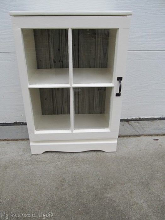 repurposed or upcycled nightstand made using a vintage window as a door