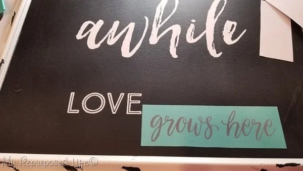 stay awhile love grows here chalkboard art
