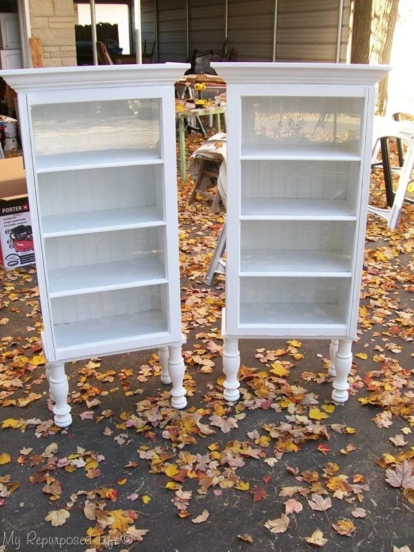 How to make repurposed window cabinets -- step by step directions on how to build the cabinet, put legs on it and use windows for doors. #MyRepurposedLife #Repurposed #windows #cabinets via @repurposedlife