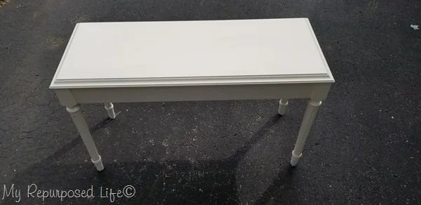 off white piano bench